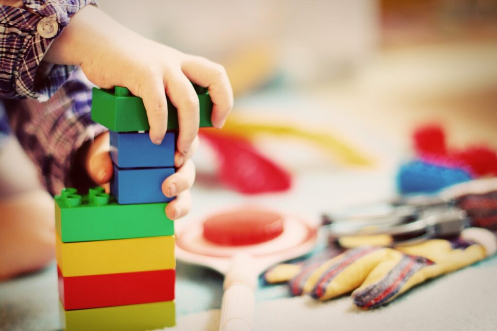 What types of activities does an occupational therapist help with for children?
