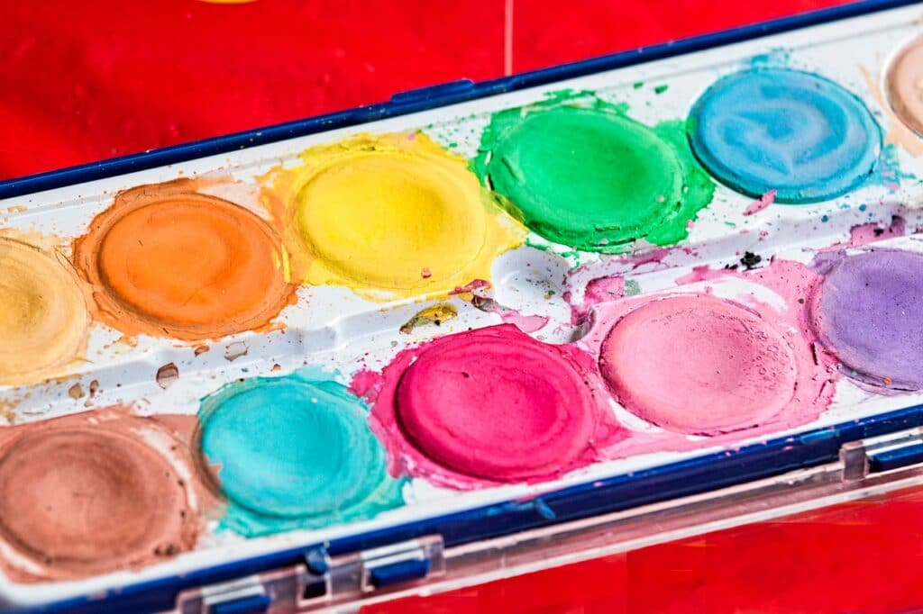 Painting is one purposeful activity that aids children during occupational therapy sessions
